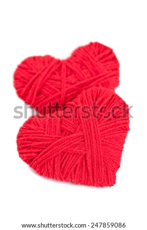 two red thread hearts isolated on white background  - stock photo