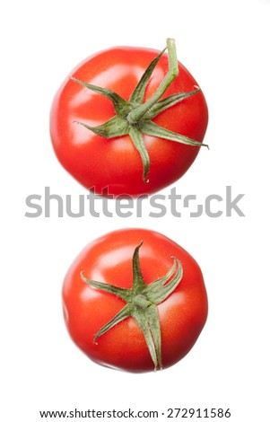 two red tomatoes isolated on white, top view