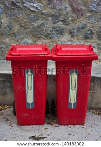 Two red trash bin. - stock photo