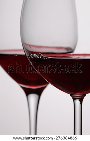 Two red wine glasses  isolated  on white background