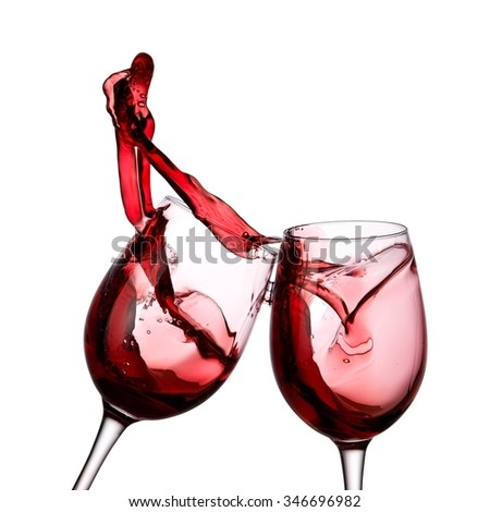 Two red wine glasses up - stock photo