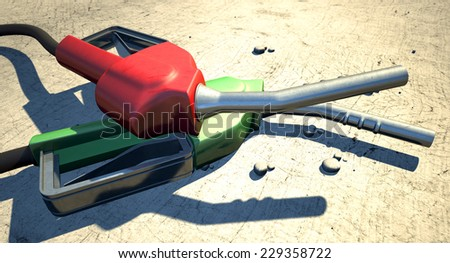 Two regular plastic and metal fuel pump handles on a desolate dry hot desert background - stock photo