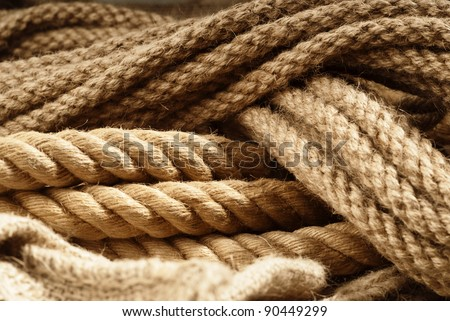 Two reliable linen fiber ropes closeup by natural strands