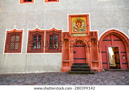 Two Renaissance doorways painted bright coral with Gothic ornament, Meissen, Germany - stock photo
