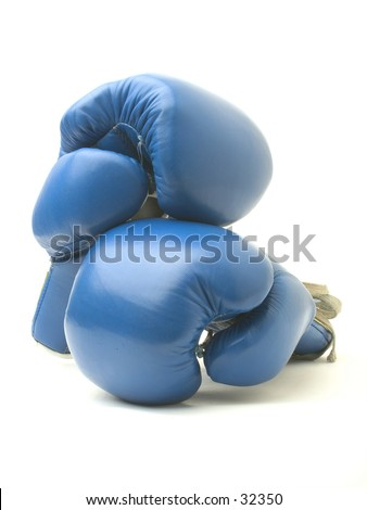Two resting boxing gloves.