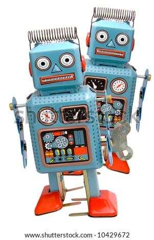two retro robots on white - stock photo