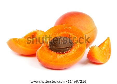 Two ripe apricot with a half isolated on a white background
