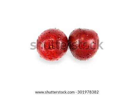 Two ripe juicy plum isolated on a white background - stock photo