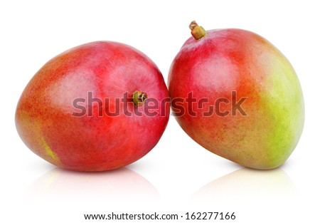 Two ripe mango fruit isolated on white with clipping path - stock photo