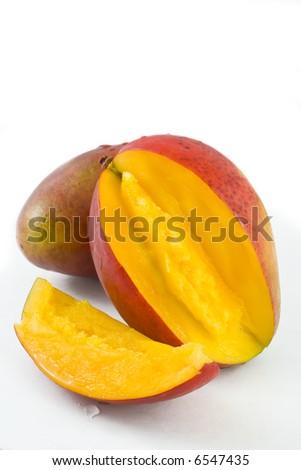 two ripe mangoes isolated on white - stock photo