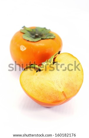 Two ripe persimmons isolated on white background