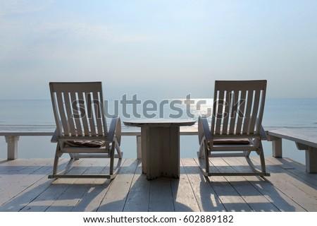 Beau Two Rocking Chairs By The Sea At Huahin Beach, Thailand
