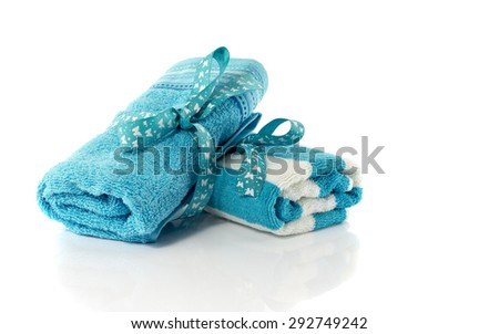 two rolled sauna towels isolated on white background