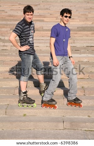 two rollers on the stairs - stock photo