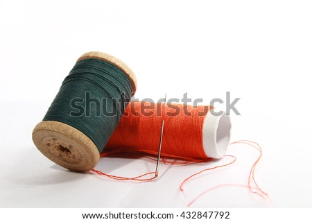 two rolls of cotton on white background - stock photo