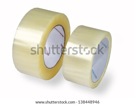 Two rolls of transparent packaging, adhesive tape, various diameters, photographed on a white background, isolated, added shadow. - stock photo