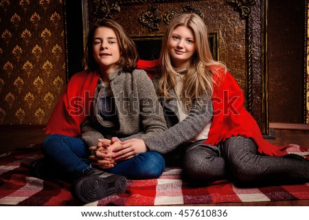 Two romantic young people spending evening together by the fireplace.  - stock photo