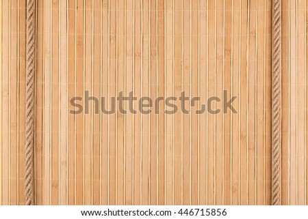 Two ropes lying on a bamboo mat, can be used as background, texture
