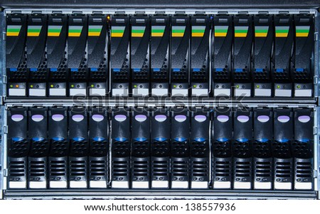 two rows of hard drive in the storage system in the data center - stock photo