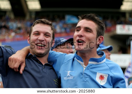 Two rugby player fans - stock photo