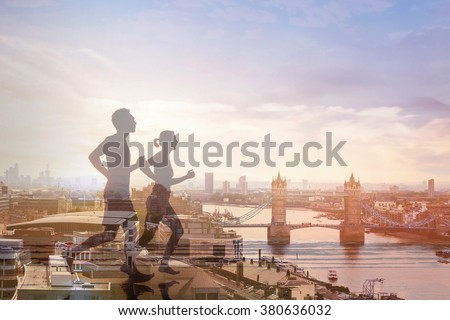 two runners and panoramic view of London, double exposure, workout and fitness concept - stock photo