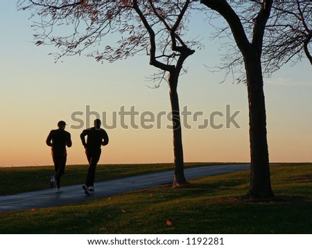 Two runners at dawn