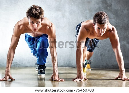 Two runners on start. Focus on face. - stock photo