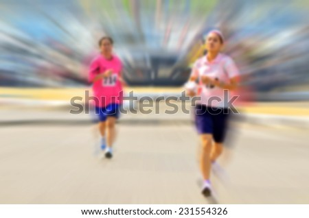 Two runners with  motion blur effect - stock photo