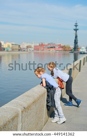 Two russian sisters walking alone Moscow river, looking sightseens, travelling in spring vacation in Russia - stock photo