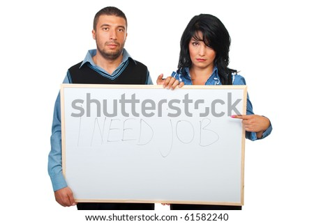 """Two sad business people holding a banner  with text: """"I need job"""",  handwritten and the woman pointing to message isolated on white background - stock photo"""
