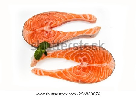 Two salmon fish cutlets isolated on white background - stock photo