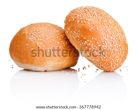 Two sandwich bun with sesame seeds isolated on white background - stock photo