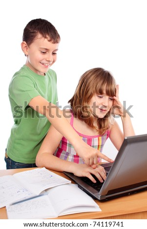 Two school children doing homework together with computer, isolated on white background - stock photo