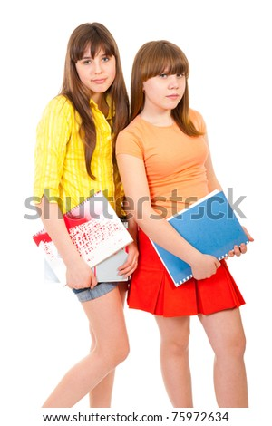 Two schoolgirls teenagers with notebooks isolated over white - stock photo