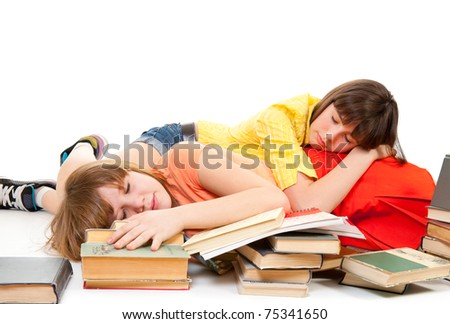 Two schoolgirls were tired of reading books and fell asleep - stock photo