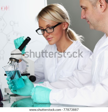 two scientist in chemical lab