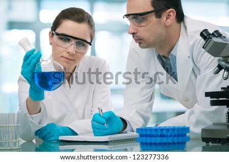 Two scientists  working in a research laboratory - stock photo