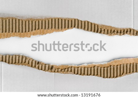 two scraps of torn corrugated cardboard - stock photo