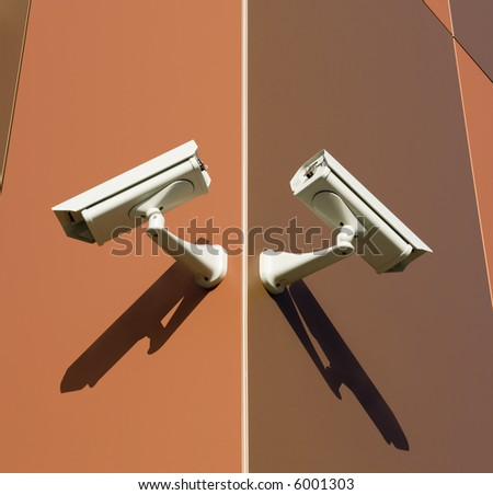 Two security cameras attached on building corner