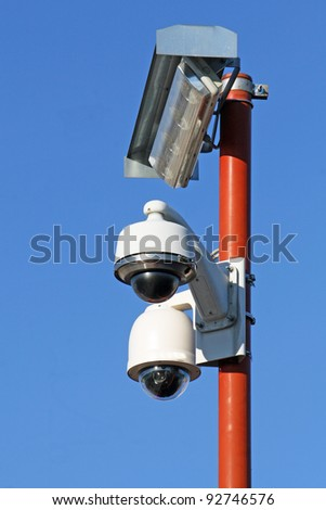 two security cameras for the safety of citizens and lamp