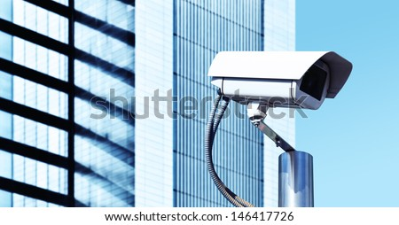 Two Security Cameras in a Modern Building Facade