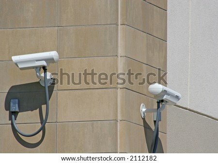 Two security cameras on exterior wall