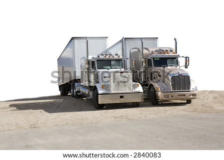 two semi trucks (semi-isolated) white background - stock photo
