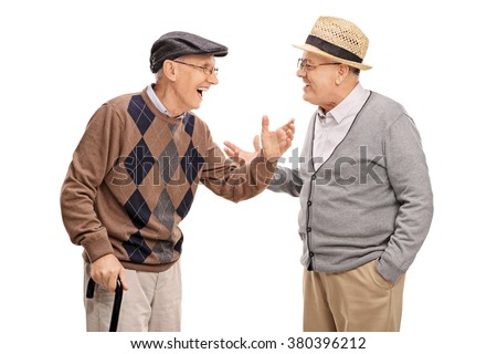 Two senior gentlemen talking to each other and laughing isolated on white background