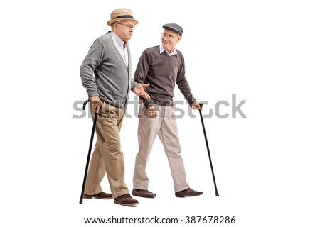 Two senior gentlemen walking and talking to each other isolated on white background - stock photo