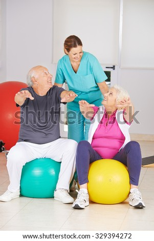 Two senior people doing fitness training in physiotherapy with physiotherapist