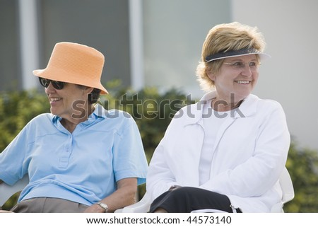 Two senior women sitting together - stock photo