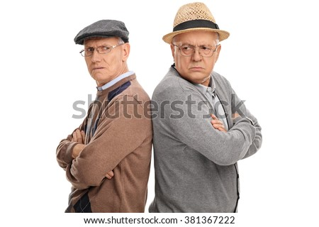 Two seniors angry with each other standing back to back isolated on white background - stock photo
