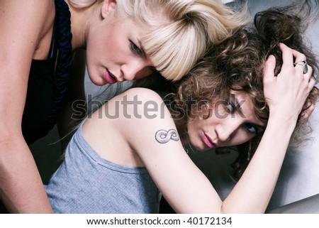 two sensual women, indoor shoot - stock photo