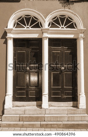 two sepia arched georgian doors in kilkenny city ireland